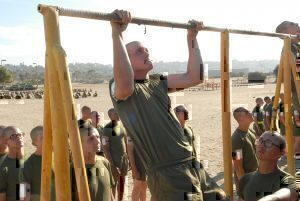 Rct.Jordan Butler, Platoon 1050, Company C. performs pull-ups during the first portion of his final PFT, 26 August. For a pull-up to count the recruits must pull their chin clear over the bar and fully extend their arms on the way down.