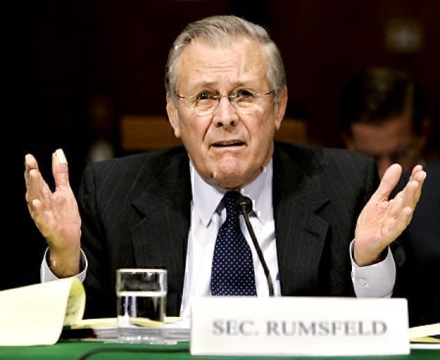 SecDef Donald Rumsfeld testifying that everything is just fine. (Photo: DoD)